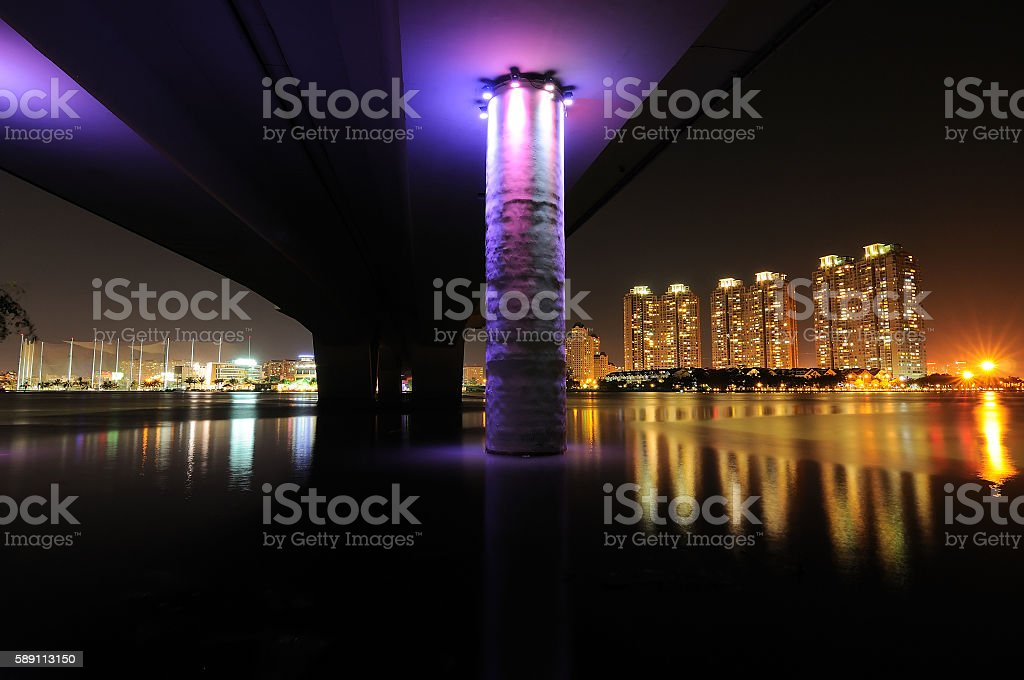 Lights of Saigon city reflected in Saigon river, Vietnam stock photo