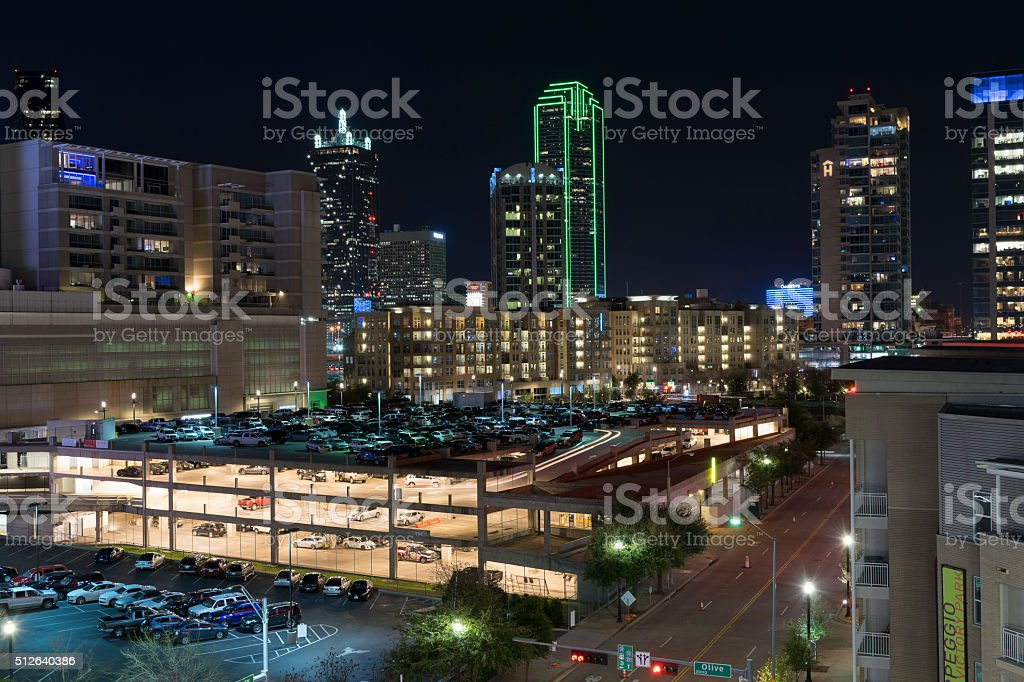 Long exposure night photograph of a lit up parking garage in downtown...