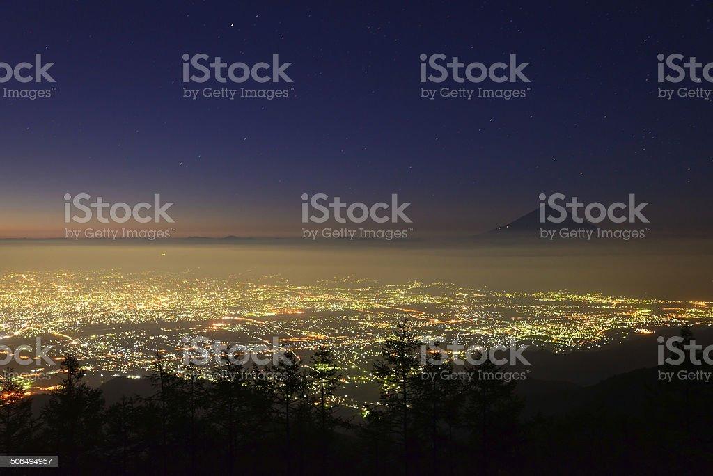 Lights of the Kofu city and Mt.Fuji at dawn stock photo
