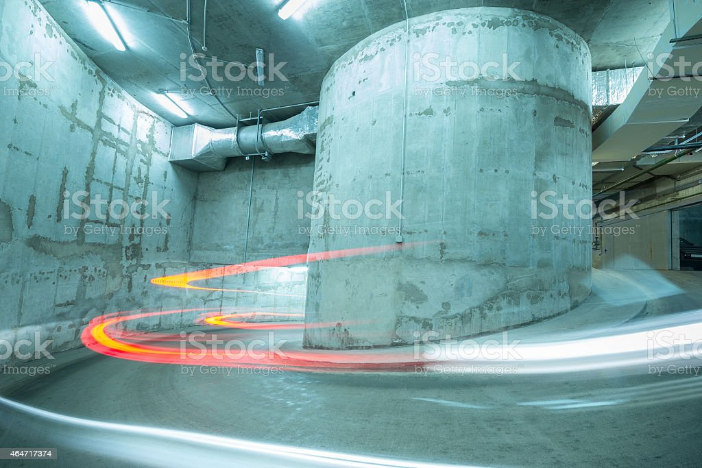 Lights of the moving car above the spiral road. stock photo