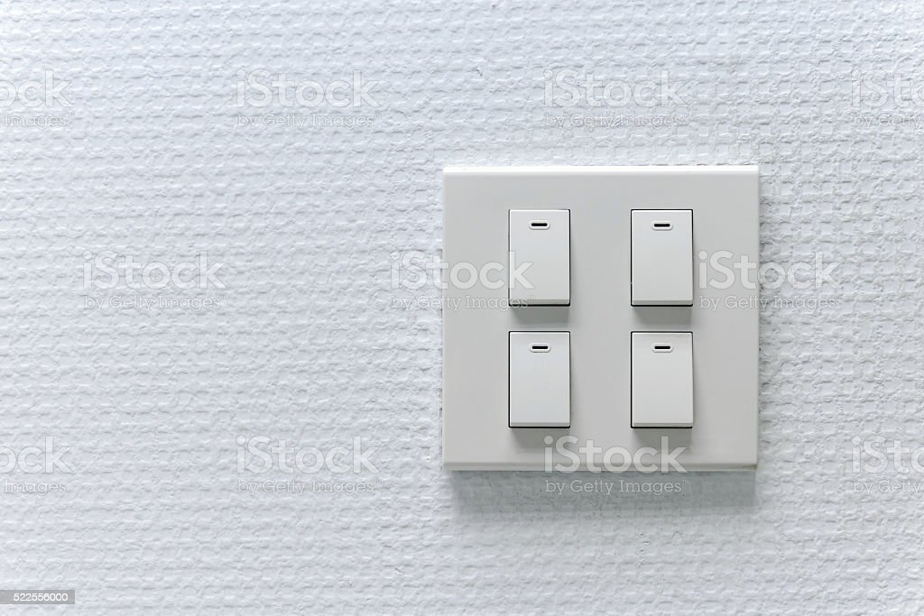 Lightswitch on the white wall stock photo