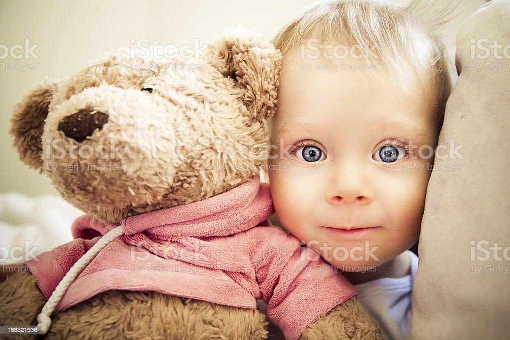 Liitle boy with teddy-bear stock photo