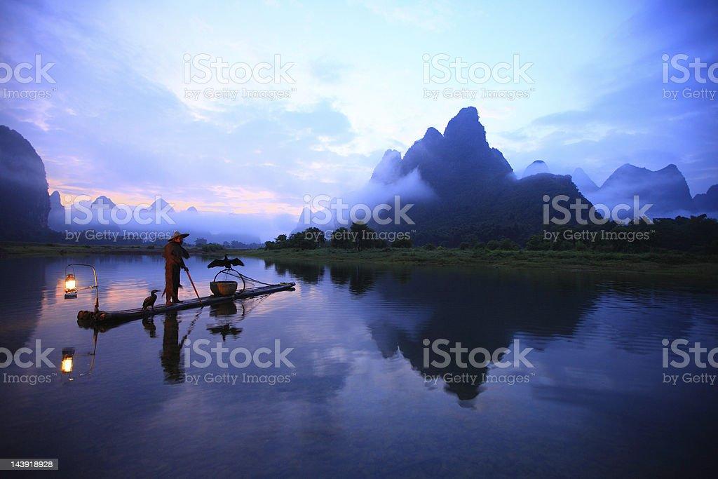 Lijiang fishermen stock photo