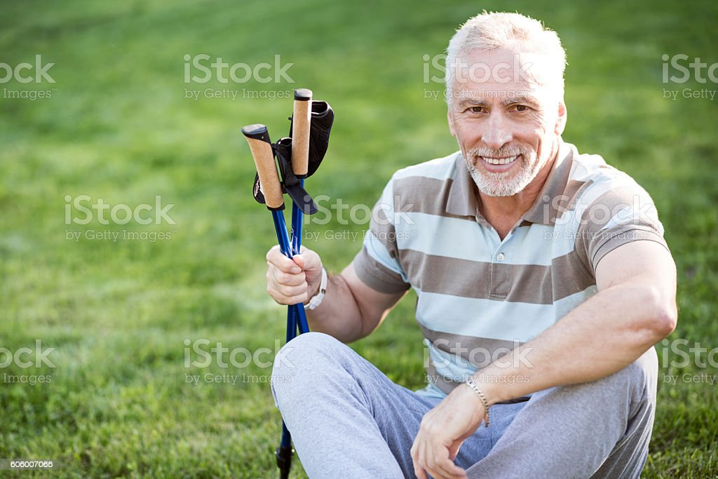 Likable old man relaxing after his training stock photo