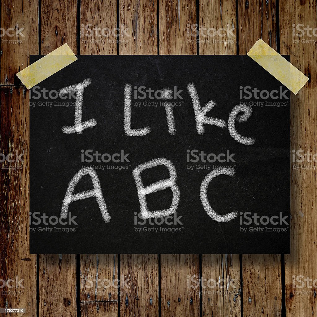 I like ABC on message note with wooden background royalty-free stock photo
