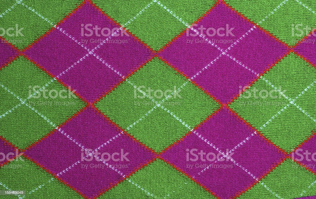 lilac and green argyle pattern fabric stock photo