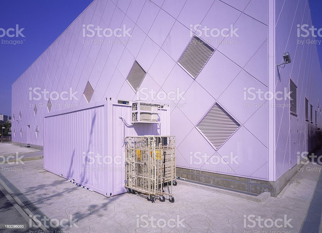 Lilac colored warehouse with container in Shanghai. royalty-free stock photo