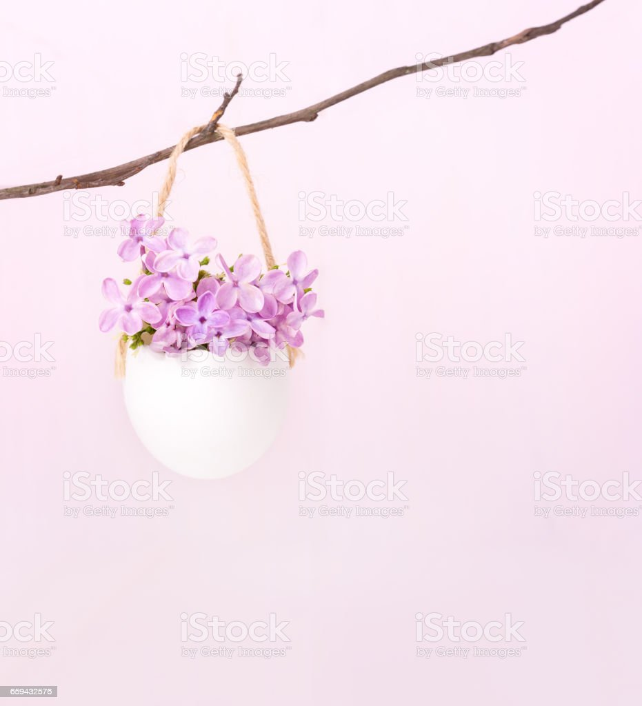 Lilac flowers (Syringa) in  egg shell.    Easter decor stock photo