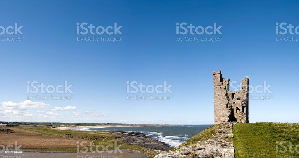 Lilburn Tower, Dunstanburgh Castle and Northumberland coastline panorama, UK stock photo