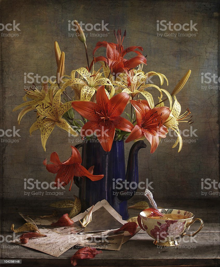Lillies in coffeepot royalty-free stock photo