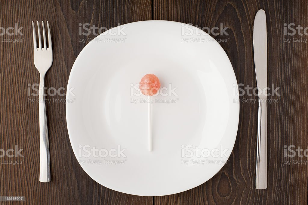 Lillipop on a white plate royalty-free stock photo