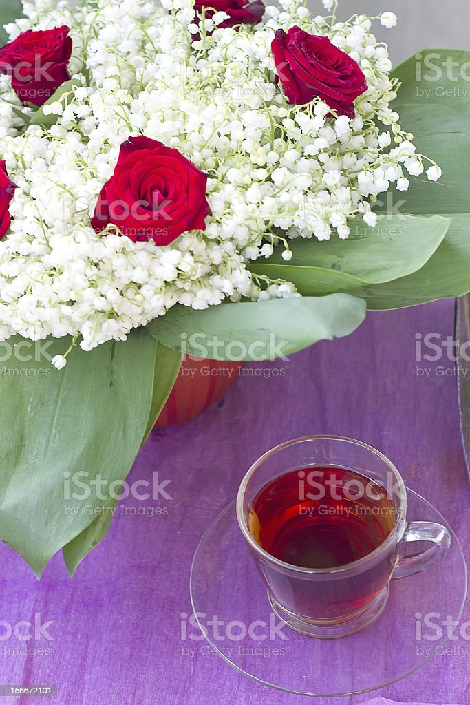 Lily of the valley and a tea royalty-free stock photo