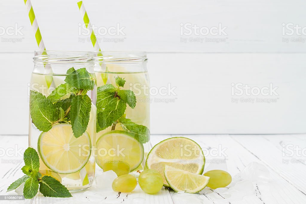 Lime and mint cocktail. Detox fruit infused flavored water stock photo