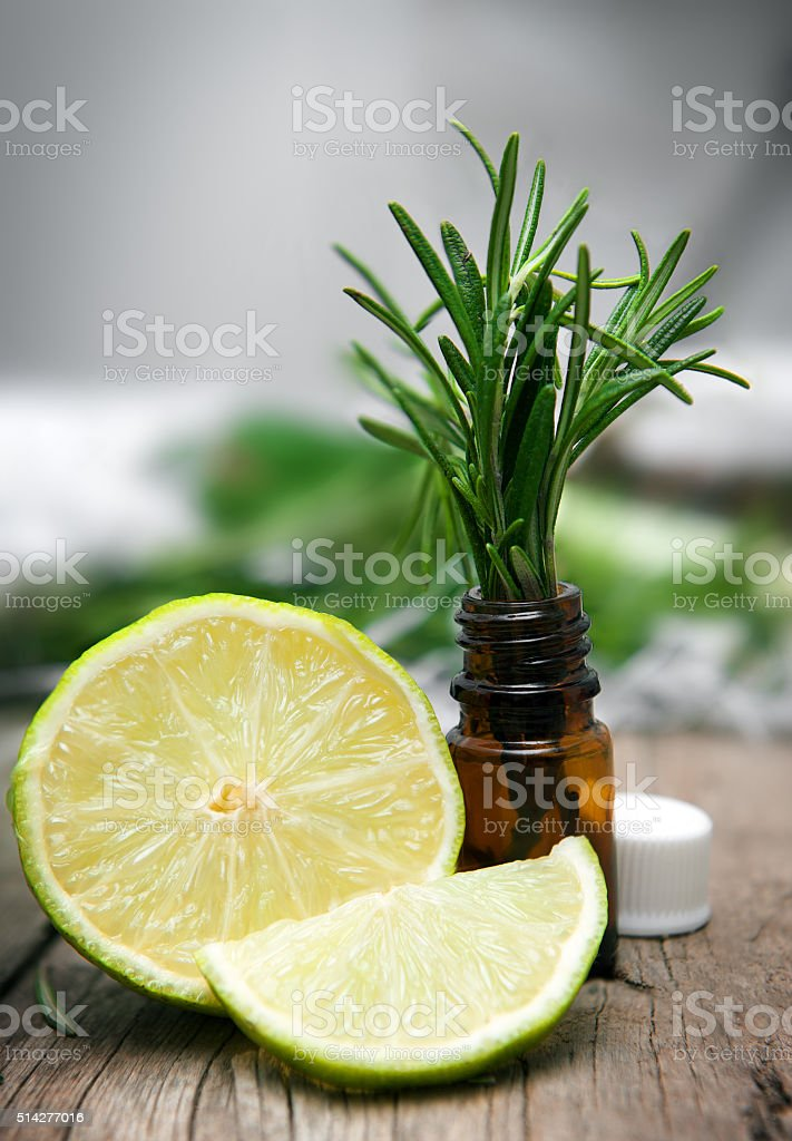 Lime and rosemary on wooden background stock photo