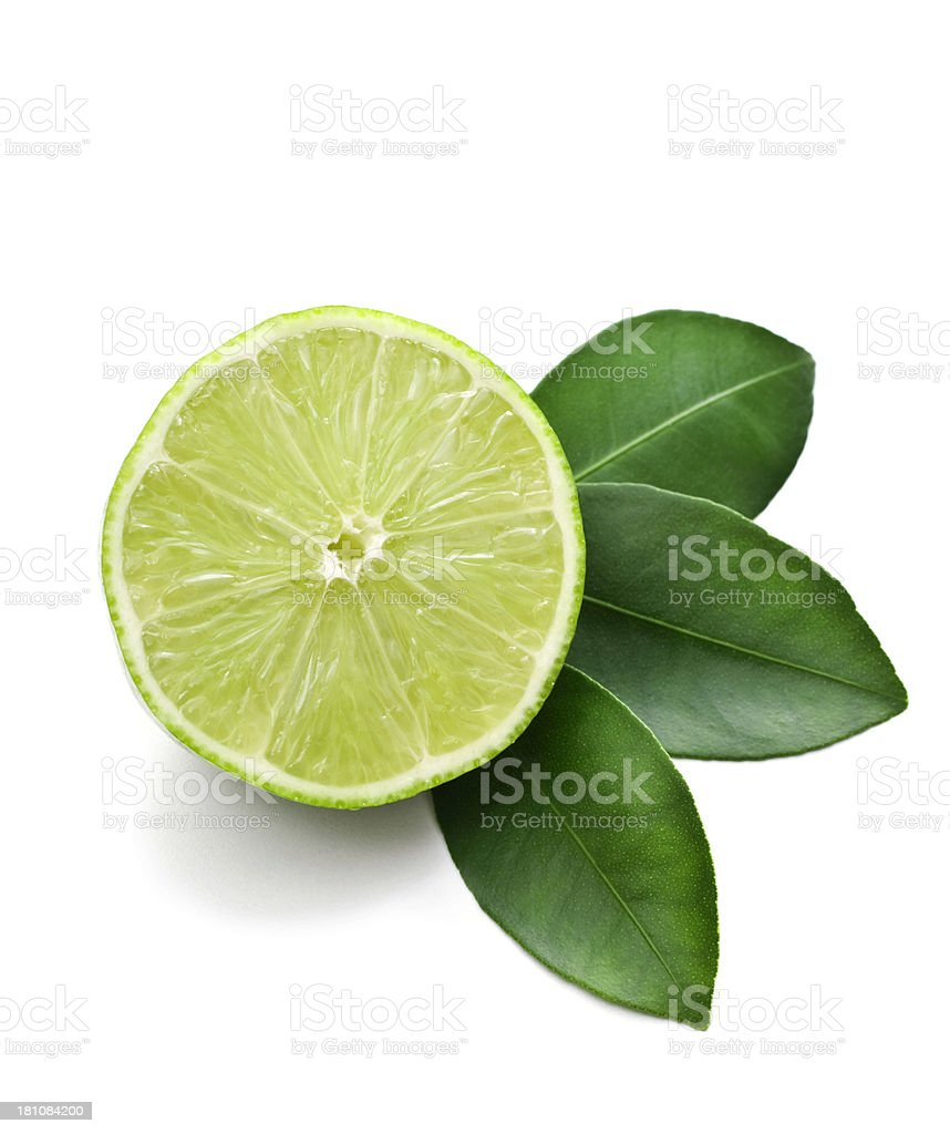 Lime cut in half against a white background stock photo