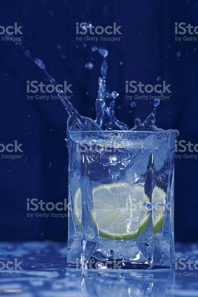 lime dropped into a tumbler royalty-free stock photo