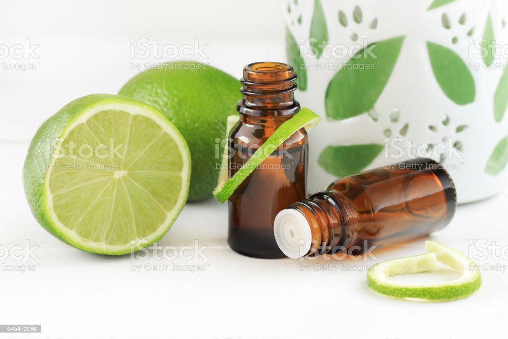 Lime essential oil. stock photo