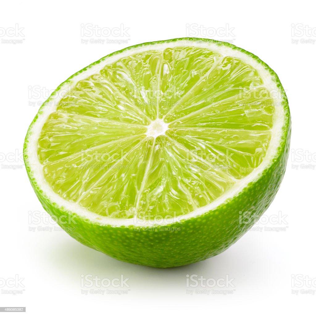 Lime fruit. Half isolated on white background stock photo