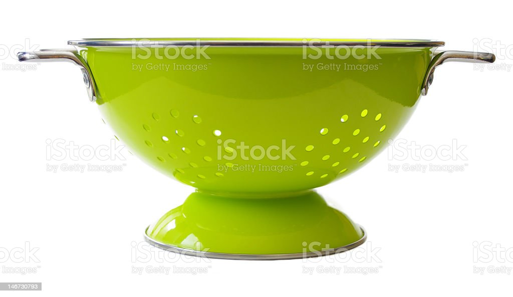 Lime green and metal colander with handles stock photo