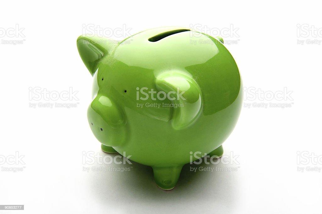 Lime green ceramic piggy bank on white studio background royalty-free stock photo