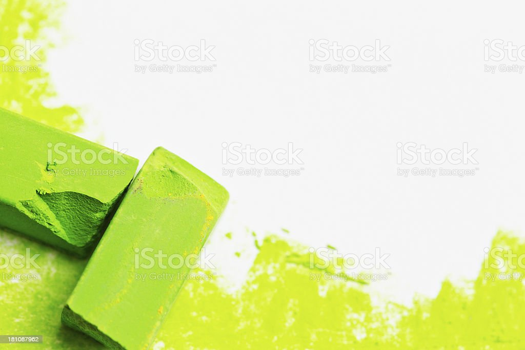 Lime green pastel crayons sketching on white with copy space royalty-free stock photo