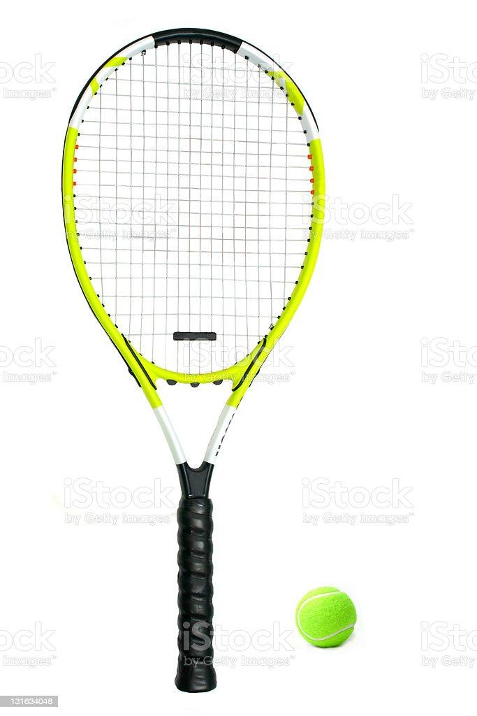A lime green tennis racquet next to a tennis ball stock photo