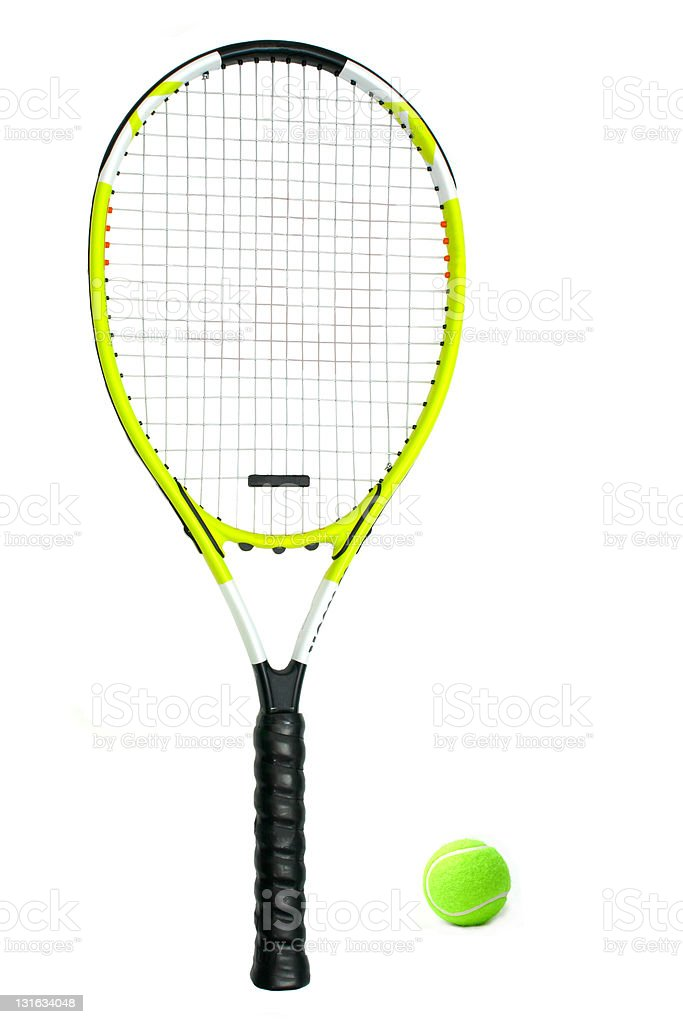 A lime green tennis racquet next to a tennis ball stock photo