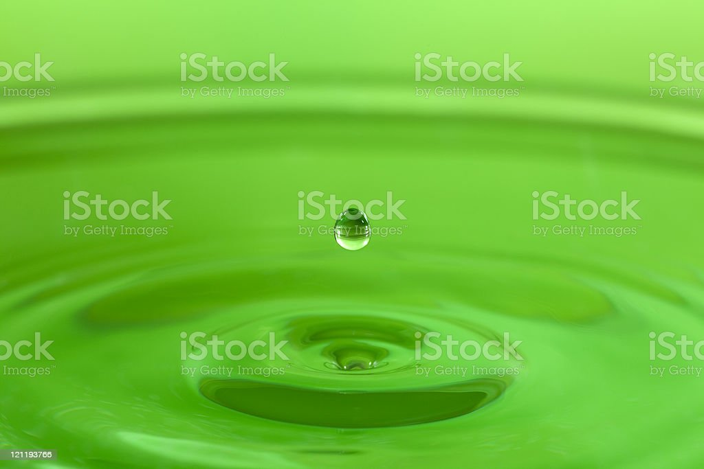 Lime green water drop stock photo