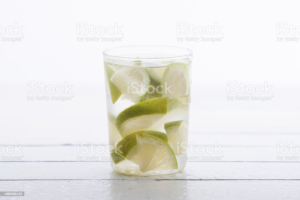 Lime in glass of water stock photo