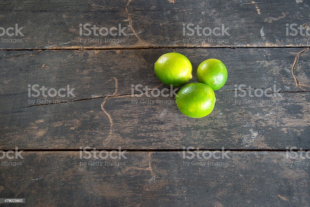 lime in white cup on wood tables stock photo