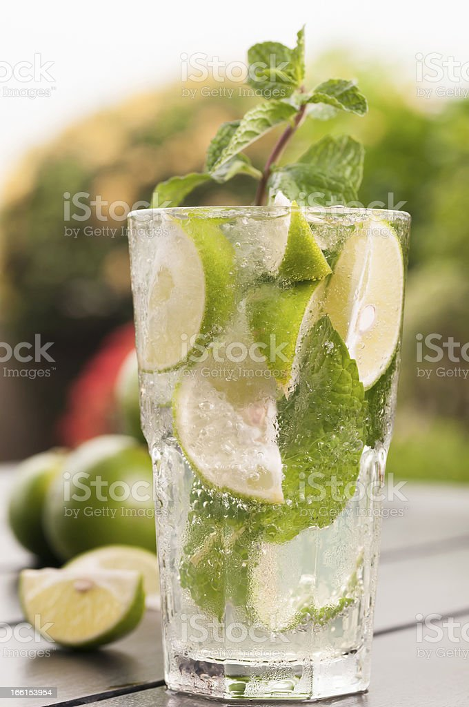 Lime Mojito cocktail extreme close-up on wooden table in garden royalty-free stock photo