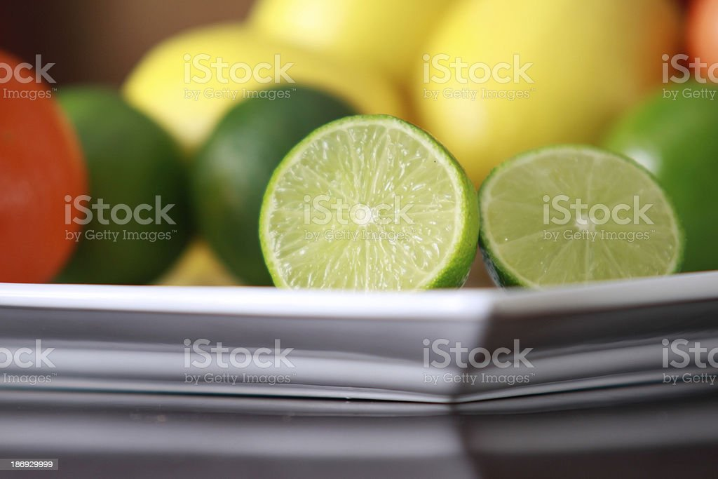 Lime on white plate royalty-free stock photo