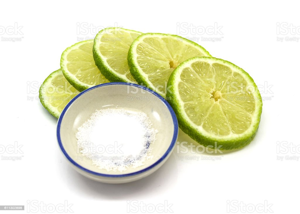 lime slices and salt isolated stock photo