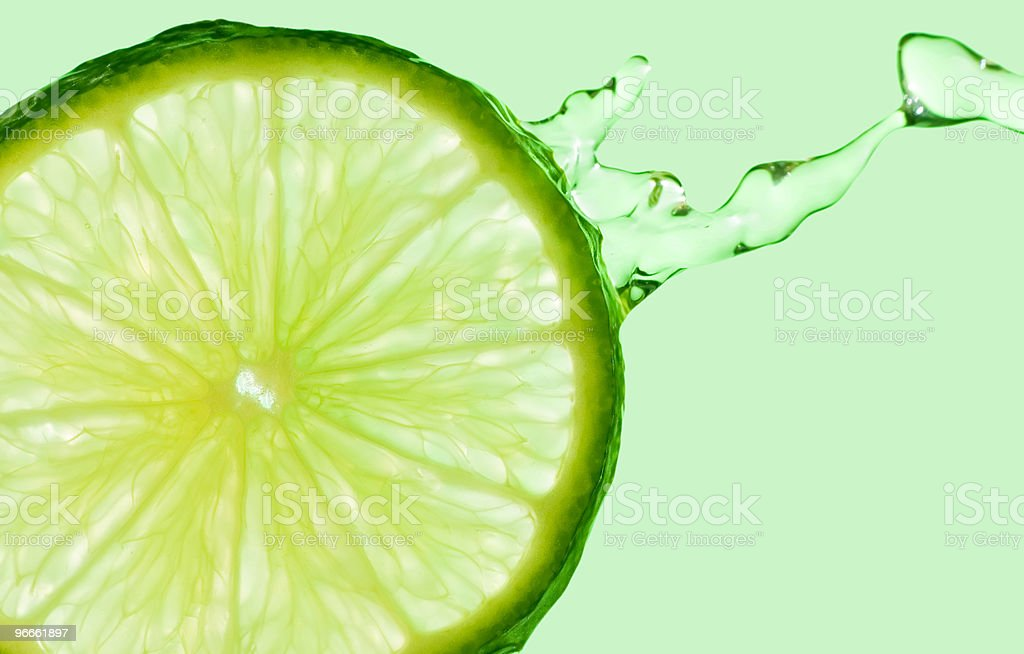 Lime Splash on Green royalty-free stock photo