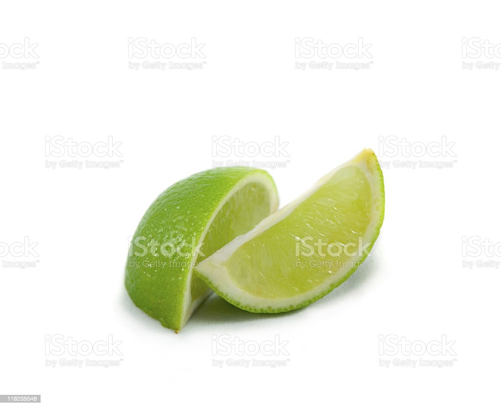 Lime wedges on white stock photo
