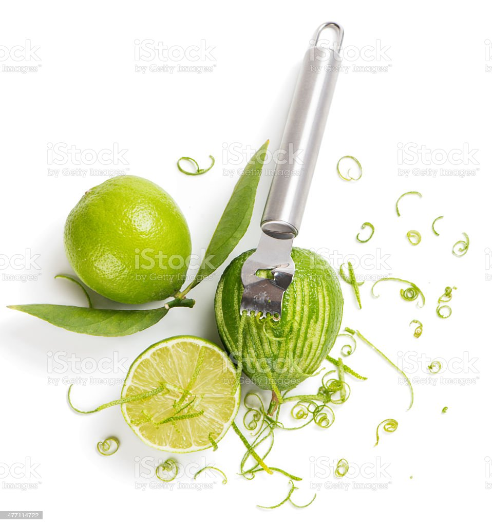 Lime zesting, view from above stock photo
