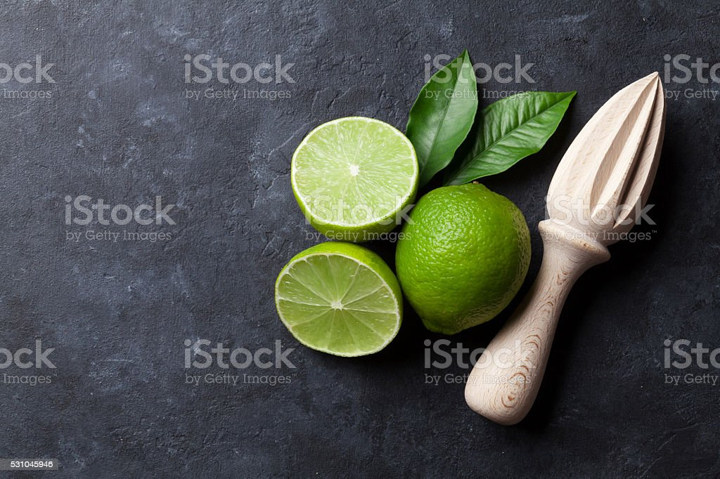 Limes and juicer stock photo