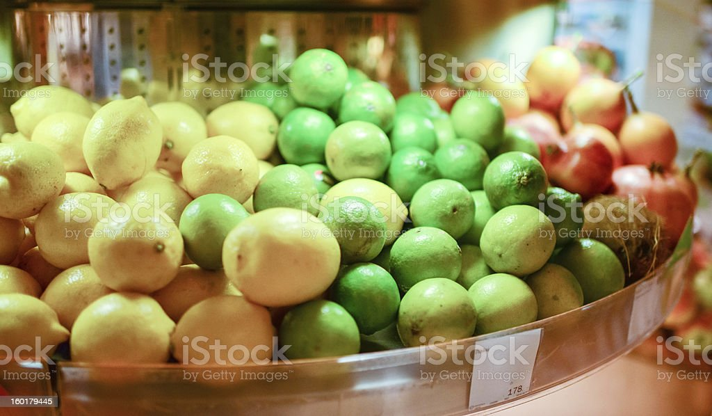 Limes and Lemons at food market royalty-free stock photo