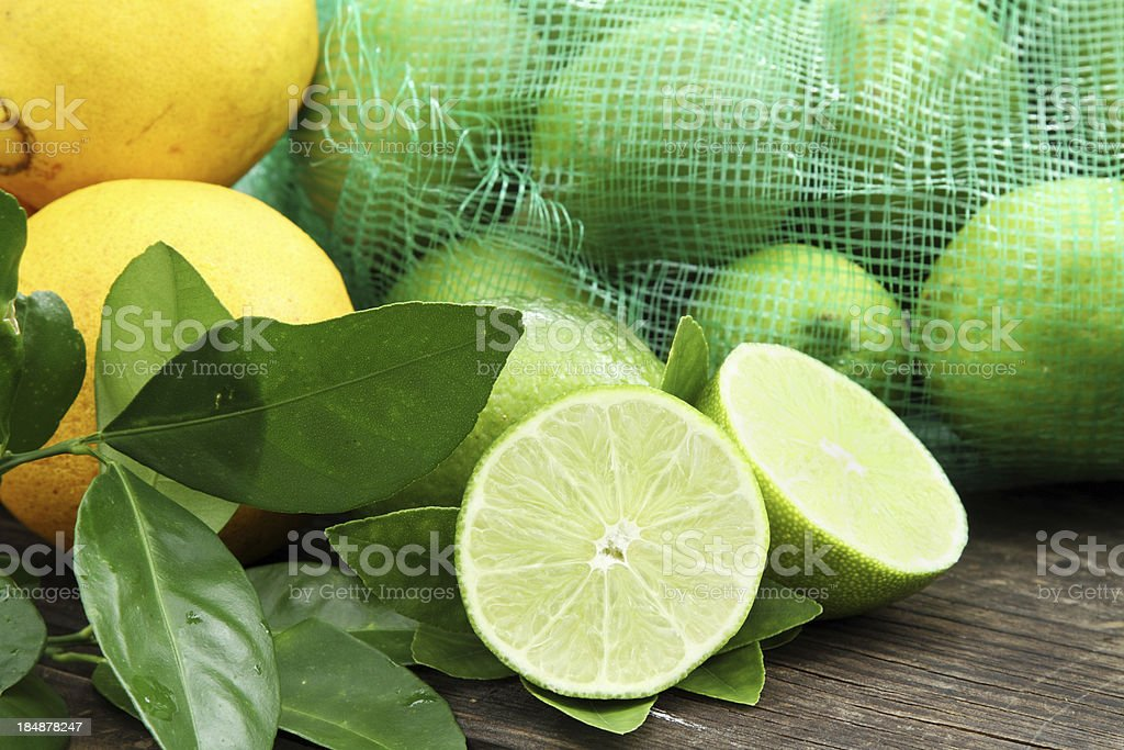 Limes and oranges royalty-free stock photo