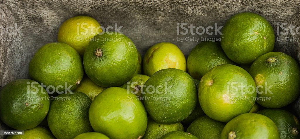 limes on the market stock photo