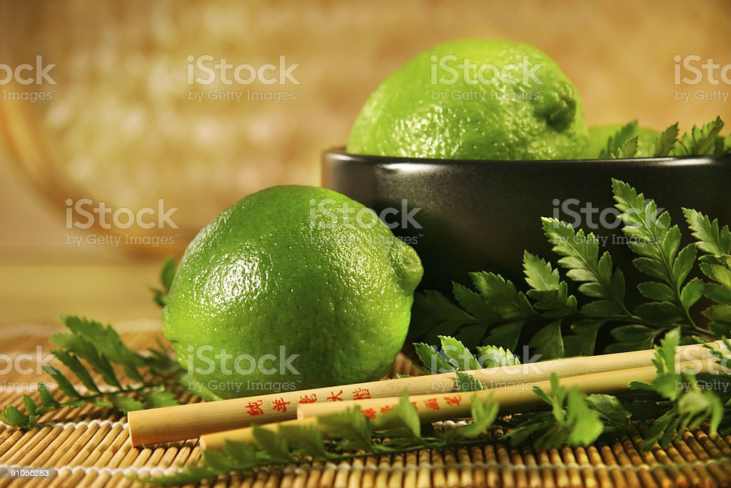 Limes with chopsticks royalty-free stock photo