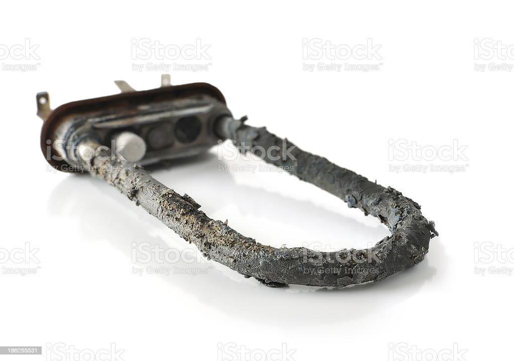 Limescale on the heating element for washing machine royalty-free stock photo