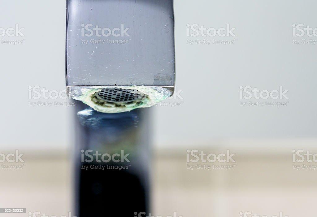 limestone deposit on a tap stock photo