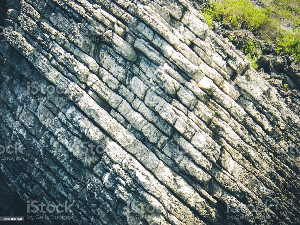 Limestone Karst Rock Geology Layers Rising Diagonally and Vegetation stock photo