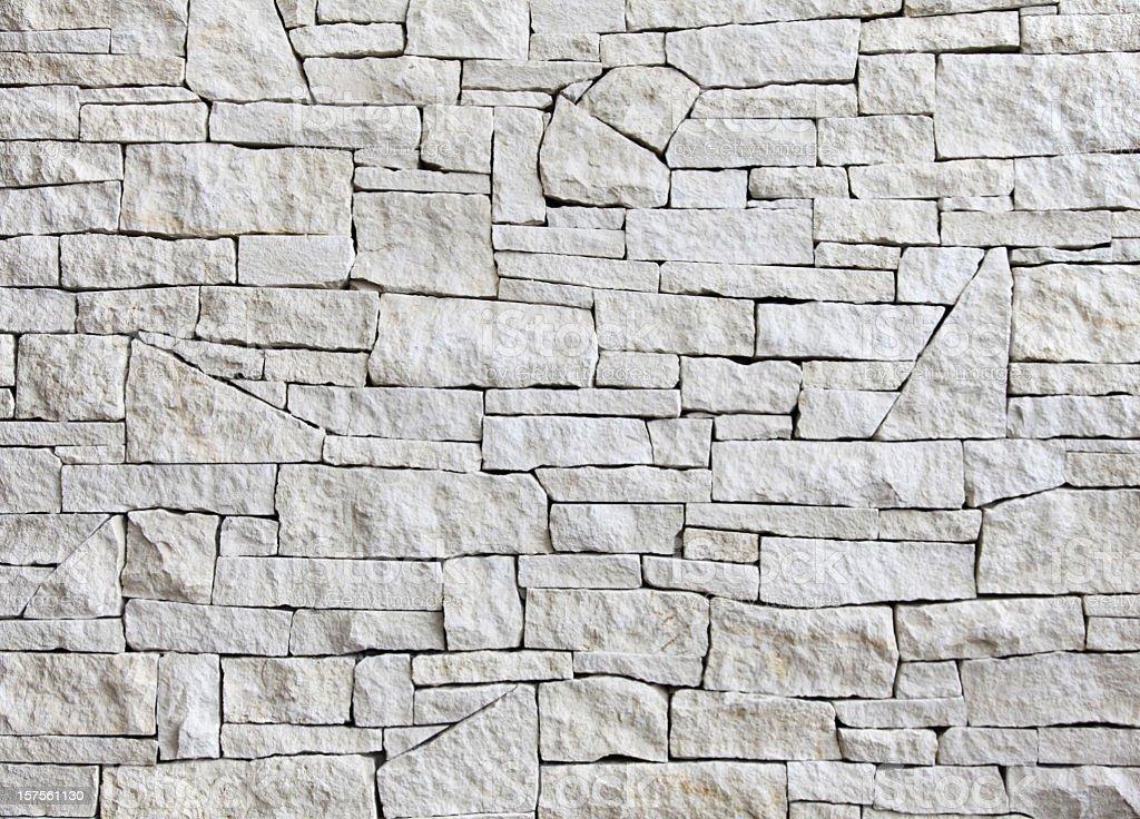 limestone wall - front view, many blocks stock photo