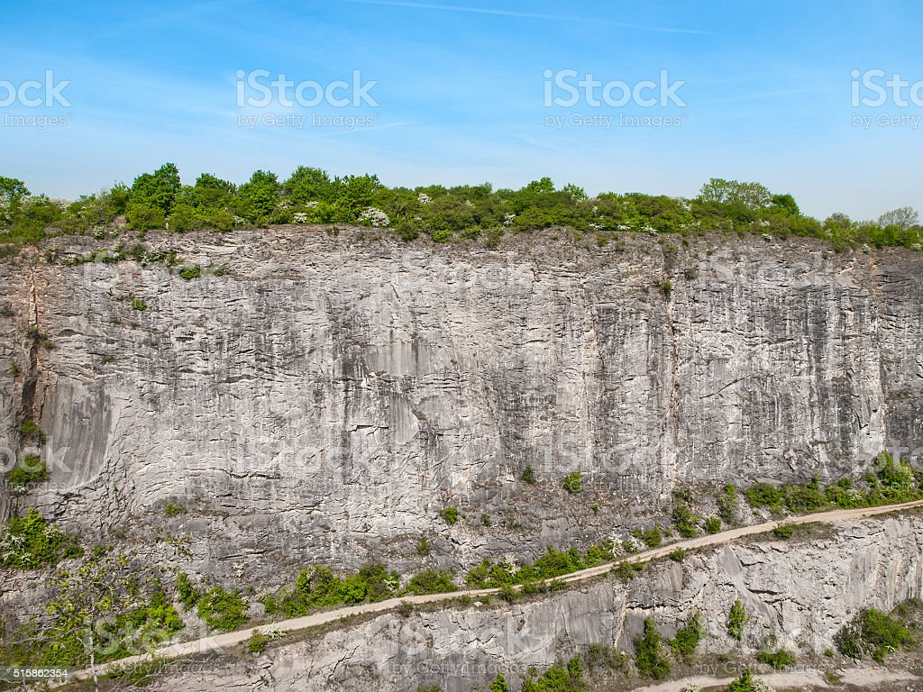 Limestone wall in quarry stock photo