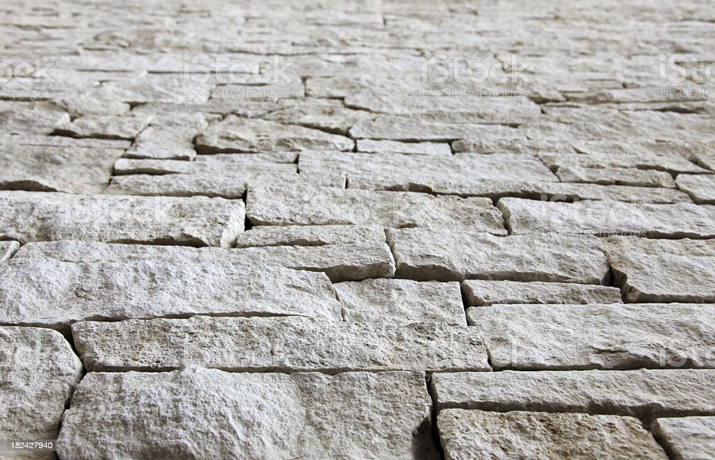 Limestone wall - selective focus from below royalty-free stock photo