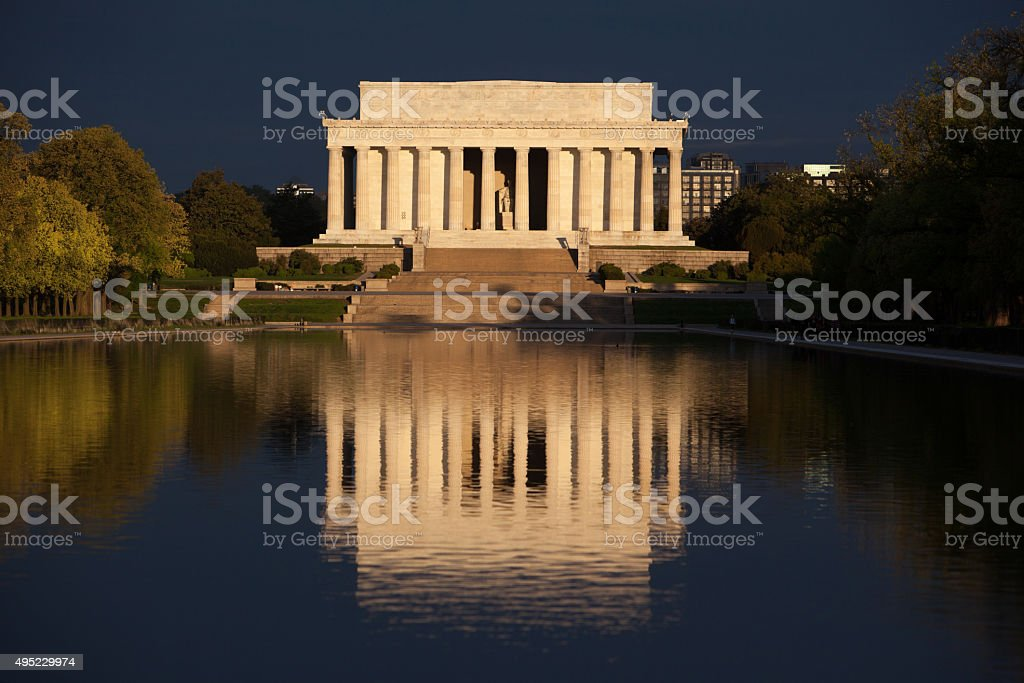 Lincoln Memorial and reflecting pool during stormy sunrise stock photo