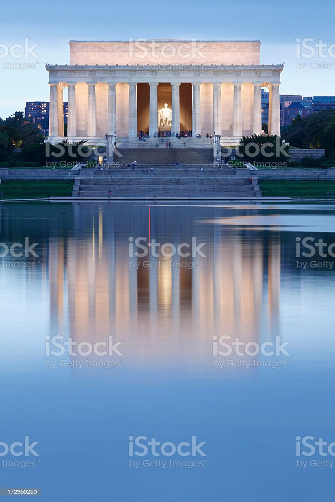Lincoln memorial lit up with reflection into pool stock photo