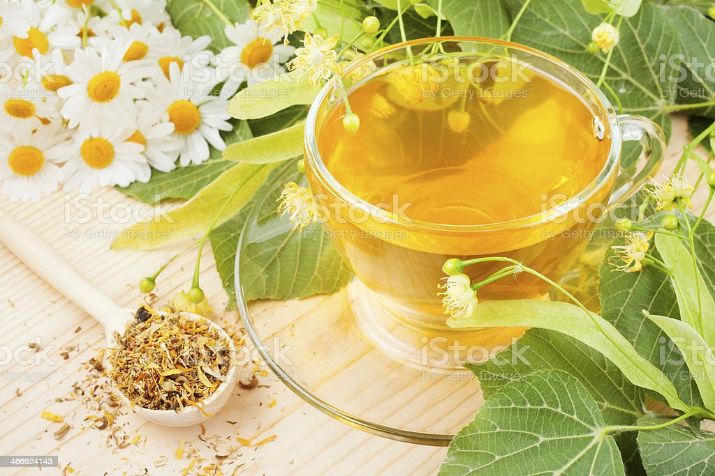 linden and chamomile flowers, cup of healthy tea royalty-free stock photo